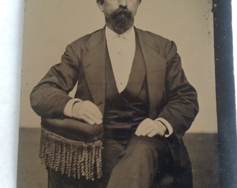 Tin type photo man in chair