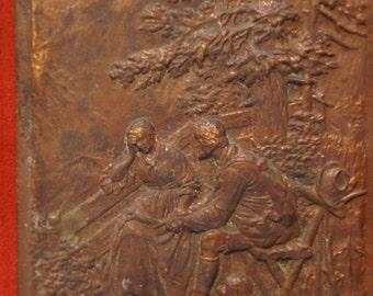 Plaque bas relief en bronze