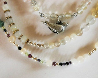 Multi-gemstone necklace with dove charm