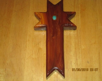 Redwood cross with a torquoise stone....