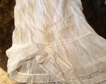 1930's child's long petticoat. Muslin and lace. Flounced. 30 chest. 28 long. Good condition. Vintage