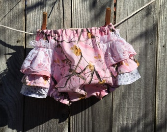 Baby girls pink camo diaper cover with ruffles, lace and a bow. Size small. Also available in sizes xxs-large.