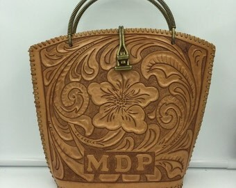 1960's leather tooled handbag with floral print.