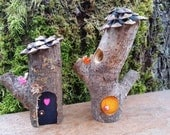 A Pair of Mini Pixie Teak Woodland Fairy Houses with Tiny Birds and Pine Cone Shingle Roofs