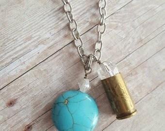 Etched bullet necklace