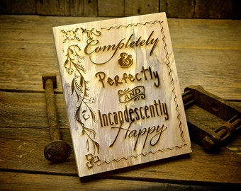 "Custom Engraved Rustic Wood Plank Wall Decor with Saying. This 8""x10"" engraved wood says""Completely & Perfectly and Incandescently Happy"""