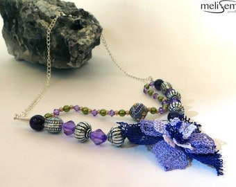 Handmade beautiful necklace with needle lace flower in different shades of purple