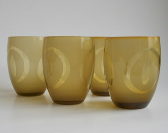 Four glass tumblers with etched retro design