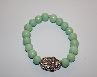 Trendy Mint green beaded bracelet with skeleton charm