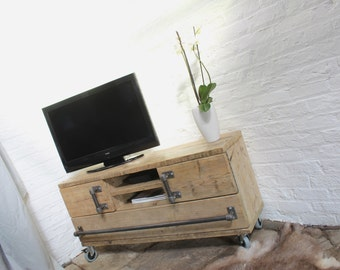 Jamila Reclaimed Scaffolding Board Long Low Media Unit with Cupboards, Apertures and a Long Drawer on Castors - www.urbangrain.co.uk