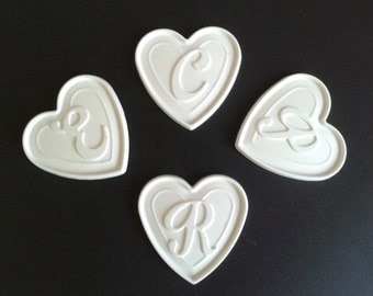 Heart with letter of ceramic powder