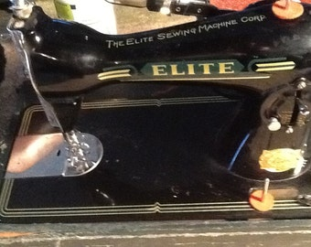 Vintage Antique gorgeous Elite Deluxe sewing machine. Made by the Elite Sewing Machine Corp