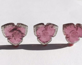 Tourmaline carvings. Matched set of three. 17.96ct