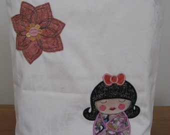 Appliqued tote with geisha and flower