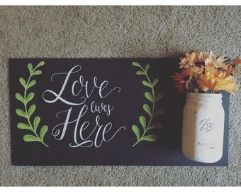 Love lives here chalkboard with mason jar