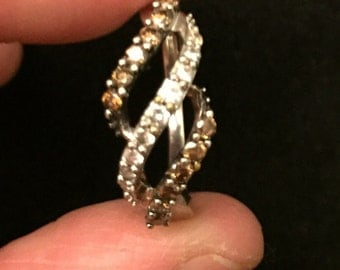 Dainty spiral ring made out of 10k white gold with white and chocolate diamonds.