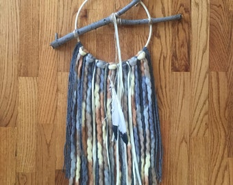 Dream catcher, yarn and suede wall hanging
