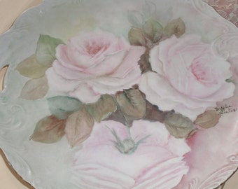 large plate with handles and big roses