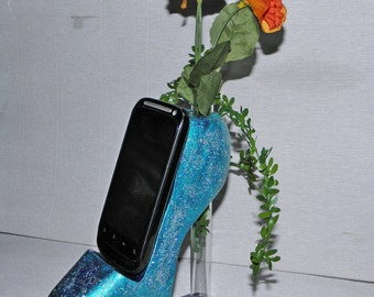 Mobile phone holder and a vase