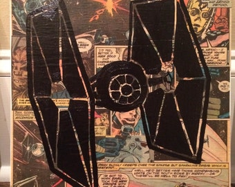 TIE Fighter Silhouette over Comics background