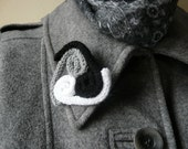 Hand knitted triskelion brooch  celtic knitted brooch   grey triskelion brooch  black and white triskelion brooch
