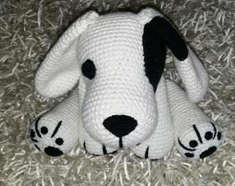 Cute dog in white with black spot