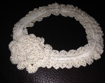 Hand-knit baby headband with a flower