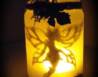 Fairy caught in jar of light.