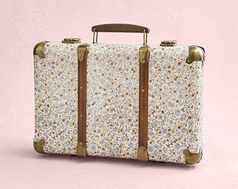The retro suitcase with flowers