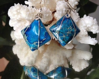 Unique earrings with blue Sea Sediment Jasper,  wrapped in a  Sterling silver wire