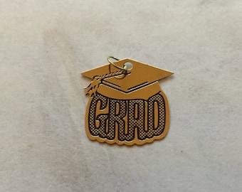 Time for Garduation celebrate with this 14 karat gold GRAD charm