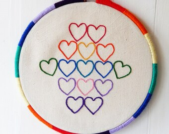 """Hand embroidered hoop art wall hanging, 21 cm (8"""") wooden embroidery hoop, rainbow hearts design, wool wrapped frame"""