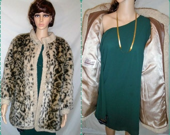 Gorgeous Vintage D'Espinta Leopard print faux fur coat for women from the 1980s.