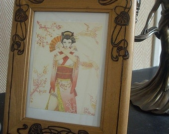 Wooden picture frame with water lily in Art Nouveau style