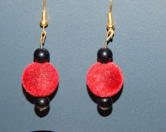 black glass and fuzzy red balls