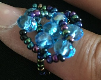 Woven iridescent and Aqua Colored Beaded Ring