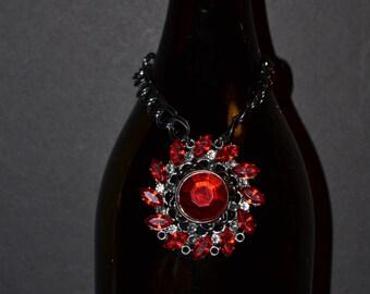 Wine bottle decoration, red rhinestones on metal work  (#B49)