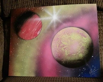 Space painting done with spray paint