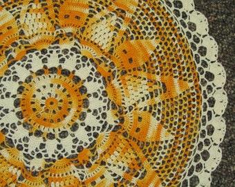 hand crocheted Sunshine doily table topper