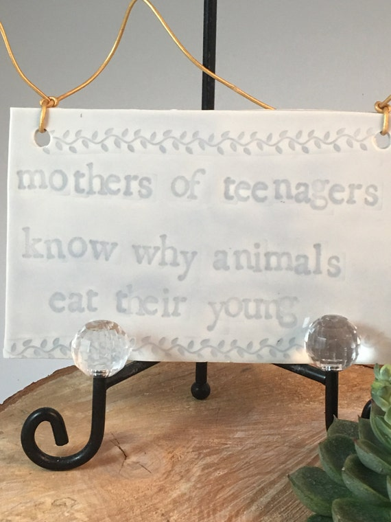 """Funny mother's day sign, """"Mothers of teenagers know why animals eat their young"""""""