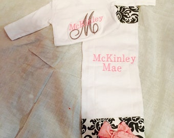 Baby girl matching onesie and burp cloth with monogrammed name.