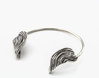 open silver bracelet