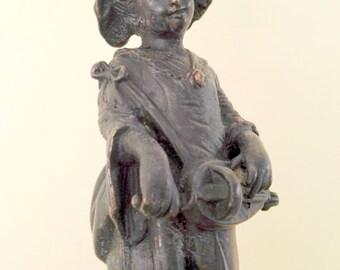 Frivolous figurine of a girl plucking on porcelain base