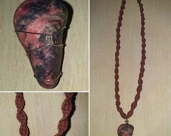 Wrapped Raspberry Rhondonite set on a brown hemp necklace