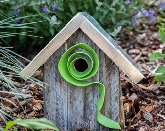 Birdhouse with funky green swirl and galvanized metal roof