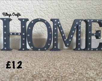 Wooden 'HOME' letters
