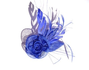In one, blue Fascinator and flower brooch