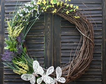Spring grapevine wreath with crocheted butterflies