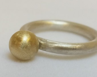 Silver ring with solid gold ball