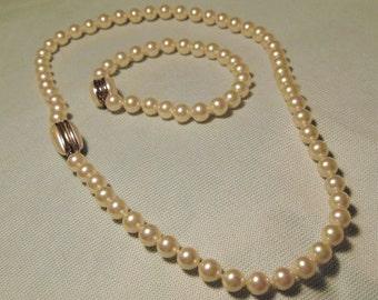 Faux pearl necklace/ bracelet combination.
